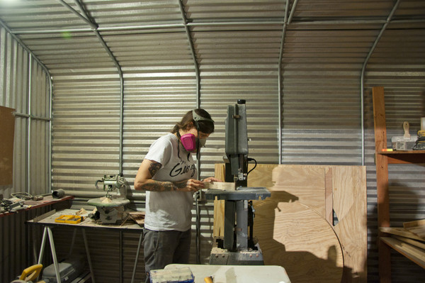 Hilary White working in her woodshop for the opening of Ingress/Egress