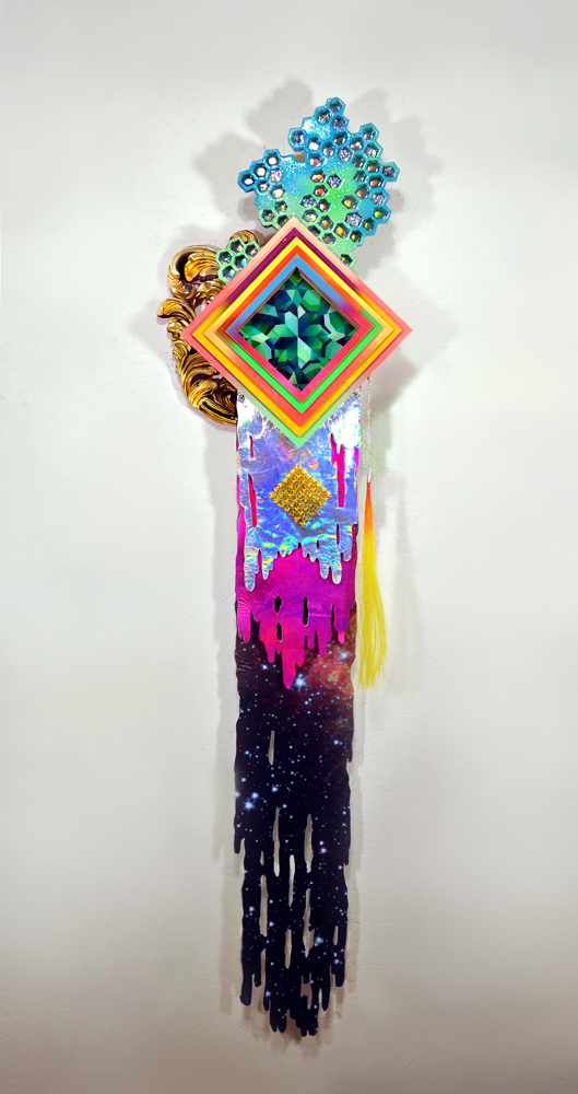 Hilary White works with paint, resin, glitter, holographic cloth, punk spikes and hair to create hand cut wood sculpture
